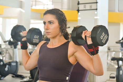 Amanda lifting dumbbells